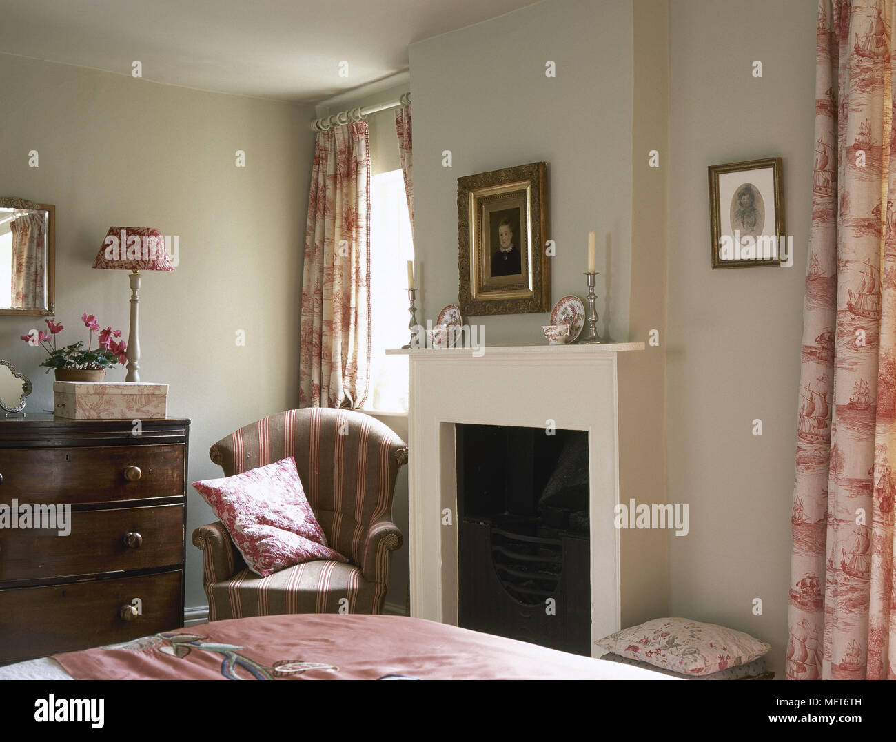 Bedroom With Red Toile De Jouy Curtains And Simple White Fireplace