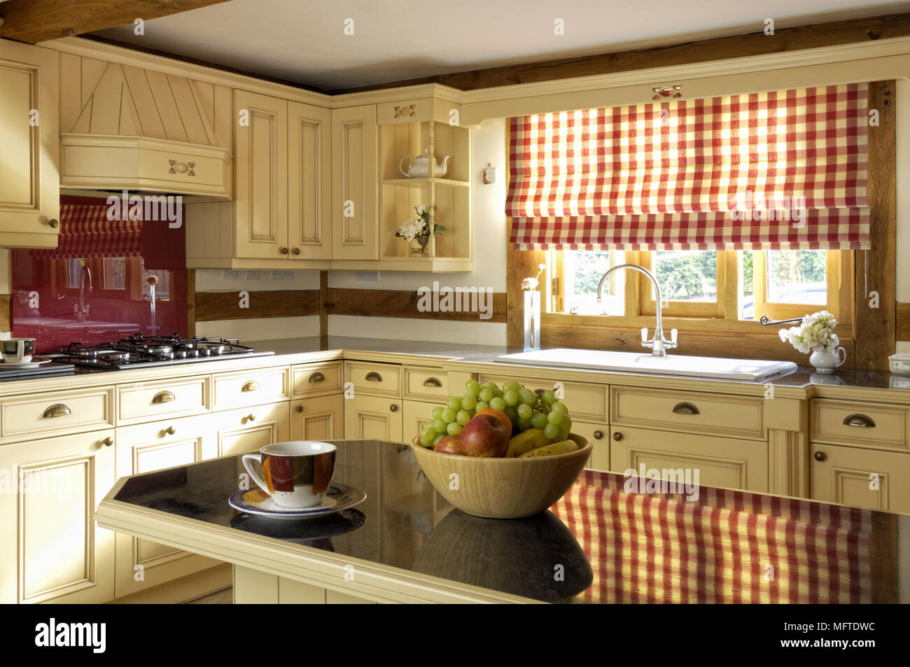 Modern Country Style Kitchen With Red Check Patterned Roman Blind At