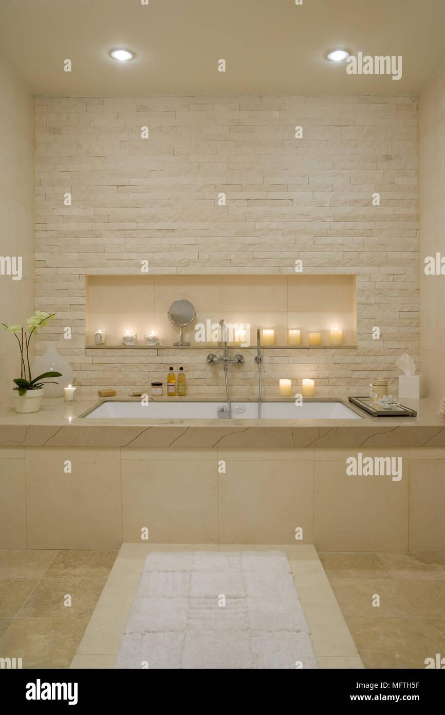 Built in bathtub set in recess in modern bathroom Stock Photo ...
