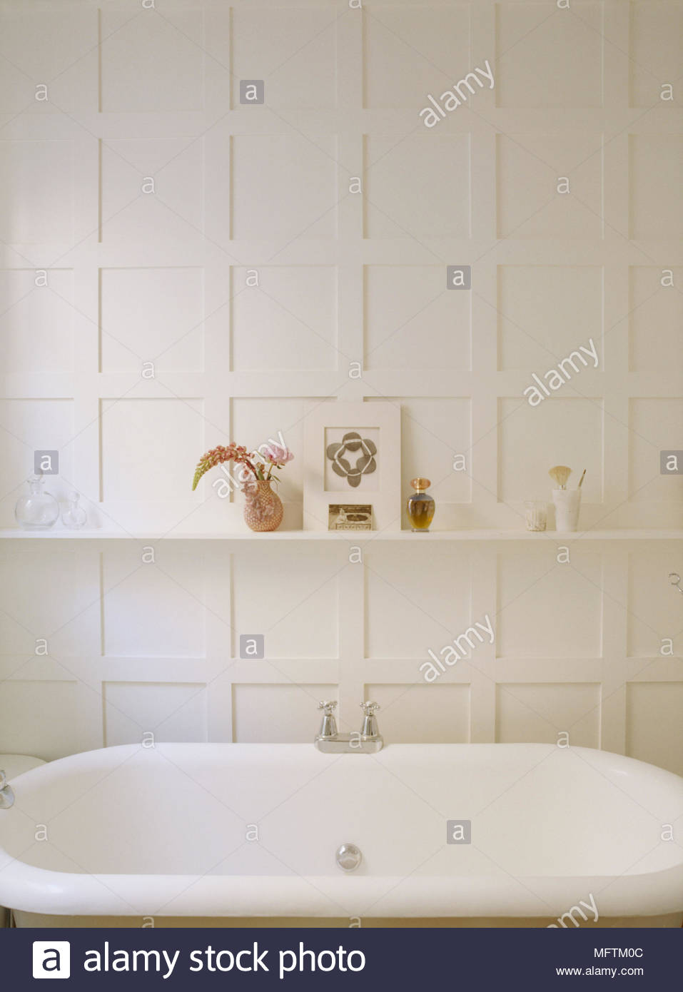 A detail of a traditional neutral bathroom with painted panelling ...