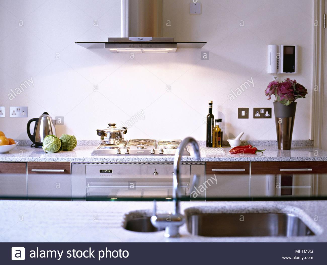 A modern kitchen granite work tops sink appliances extractor fan ...