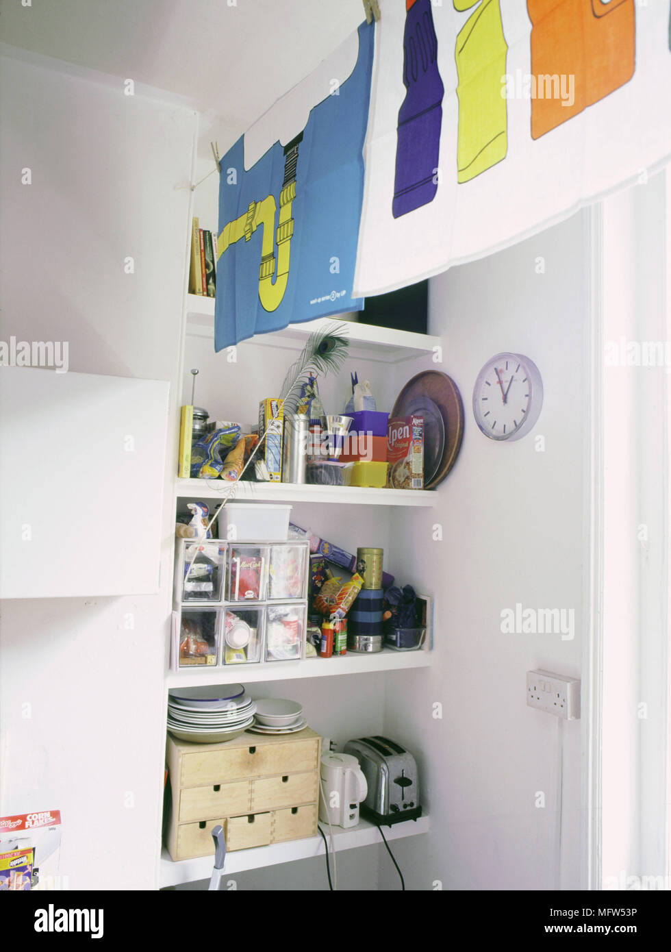 Niche Shelving Cluttered With Miscellaneous Kitchen Items.   Stock Image