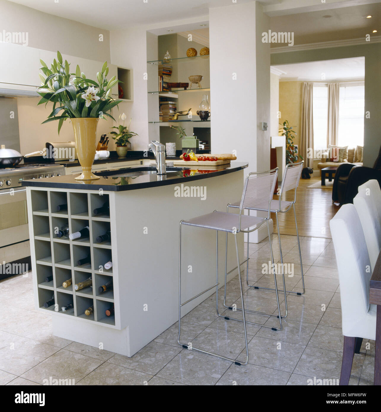 A modern kitchen with dining area breakfast bar unit wire stools ...