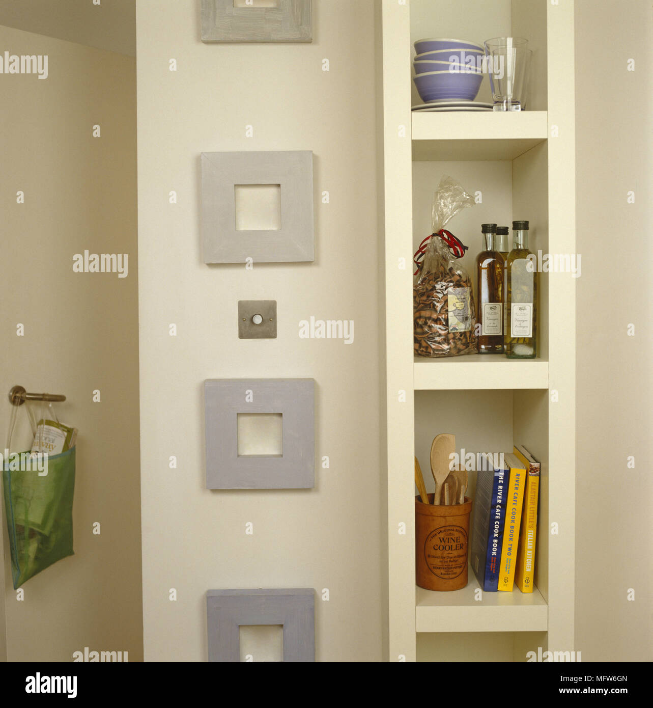 Built in shelving detail picture frames kitchenware Stock Photo ...