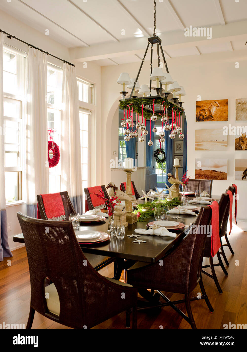 Christmas Decorations Hanging From Chandelier Above Table Laid For Lunch In Country  Style Dining Room