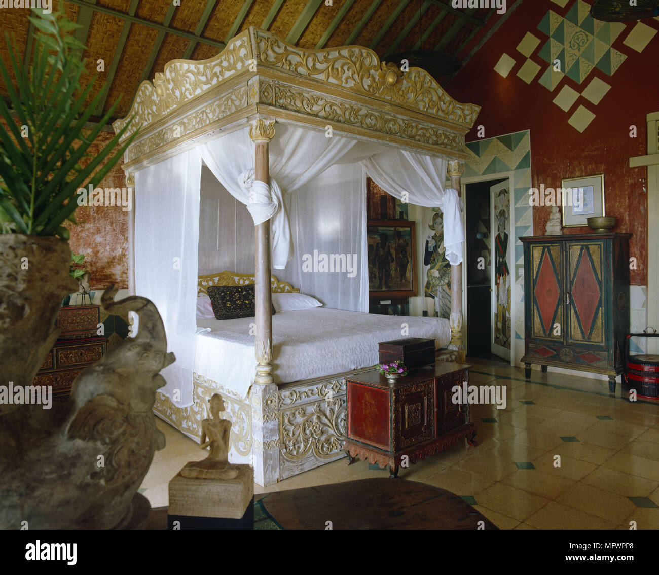 Ornate Four Poster Bed With Canopy In Room With Decorated Walls And Tiled  Floor