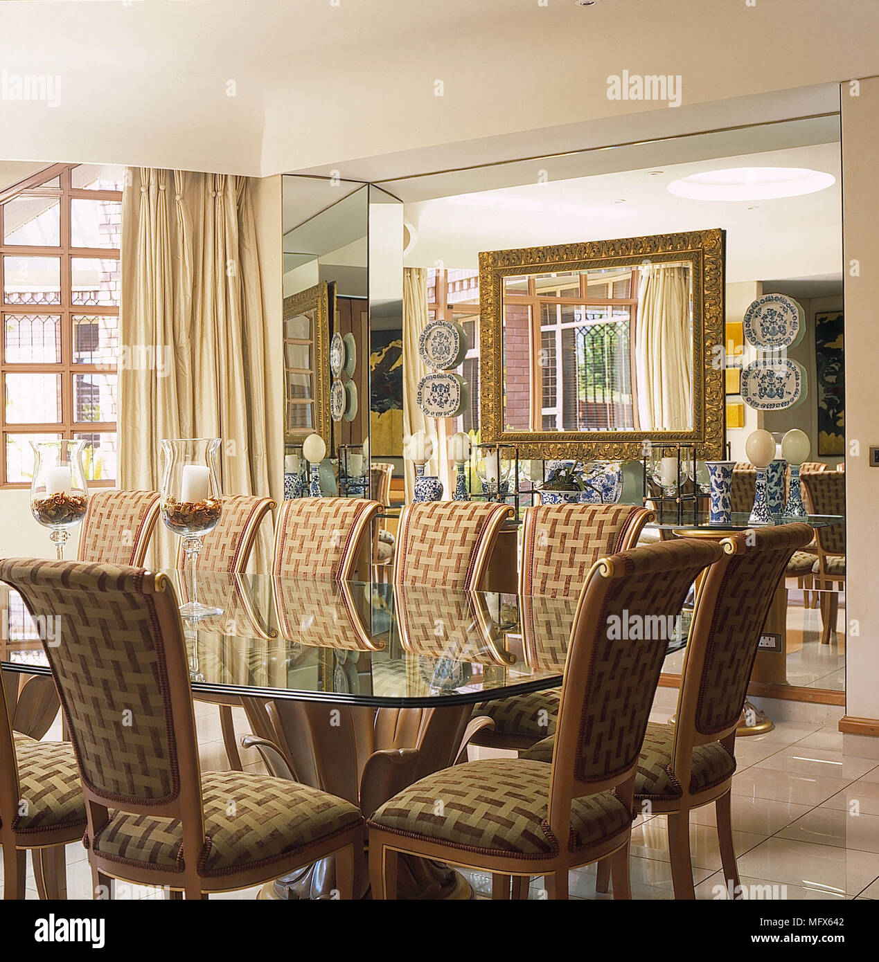 Dining Room White Walls Tiled Stone Floor Mirror Wall Glass Table Brown  Beige Covered Chairs Cream Curtains Interiors Rooms Gold Mirror Blue White  Chi