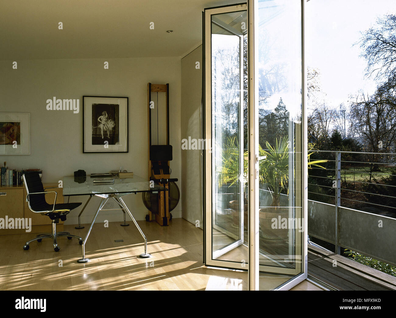 Home Office With Glass Sliding Door On To Balcony Stock Photo