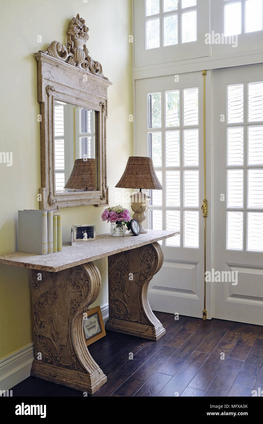 L Mirror Above Stone Hall Table In Traditional Style Hallway
