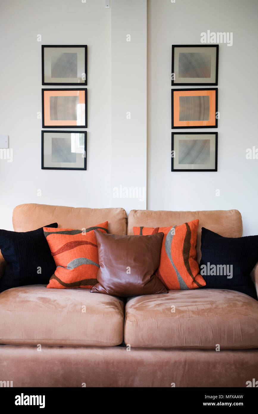 Brown Sofa With Orange Black And Red Cushions Stock Photo