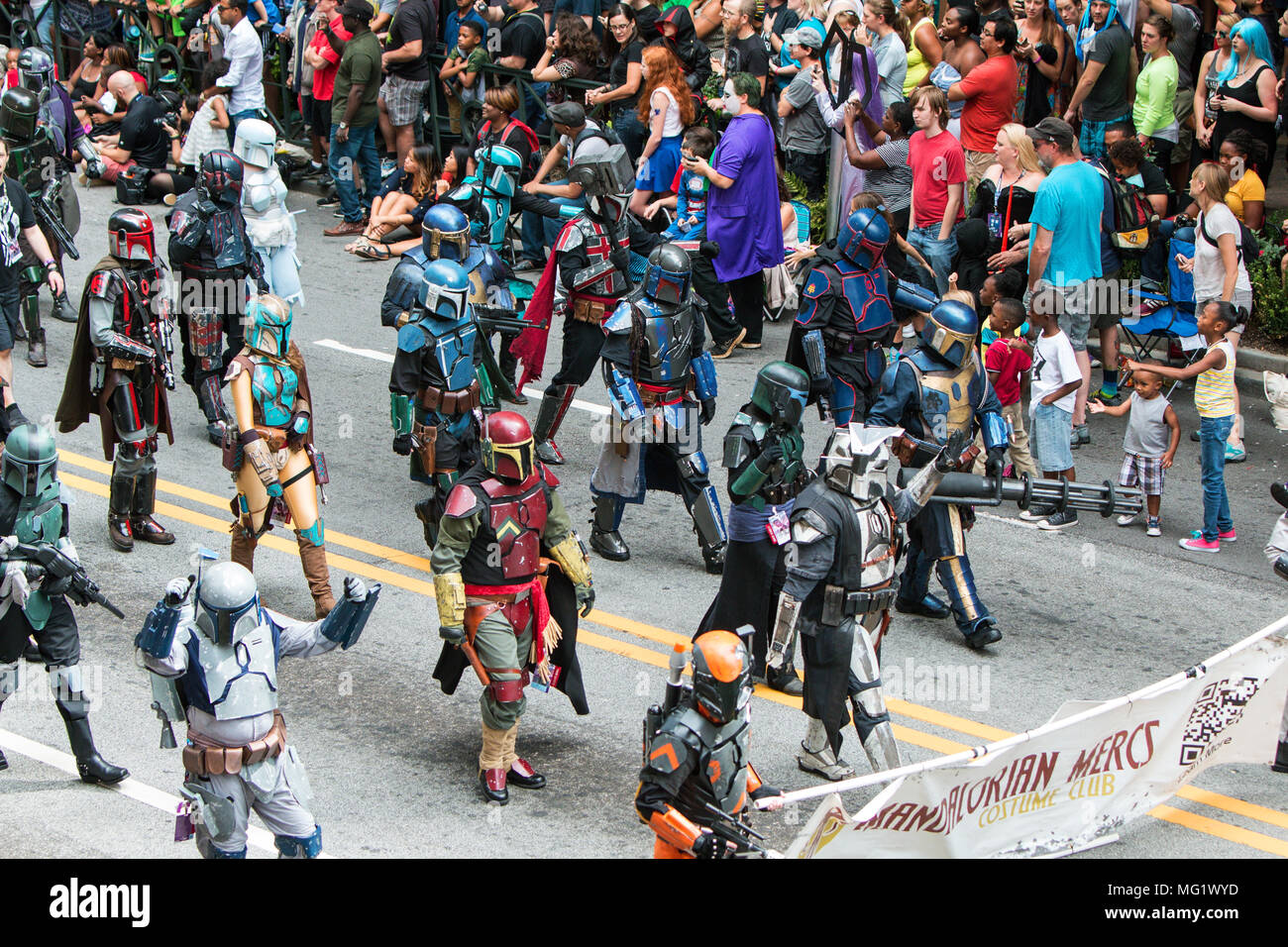 People dressed like Mandalorian Mercs from the Star Wars movies, walk in the annual Dragon Con Parade on September 3, 2016 in Atlanta, GA. - Stock Image