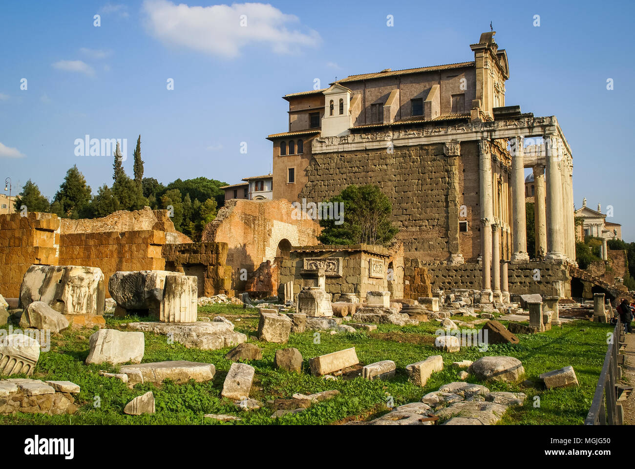 Architectural ruins on the ground next to Temple Antoninus and Faustin, now used as Church of San Lorenzo in Miranda. Roman Forum; Rome, Italy - Stock Image