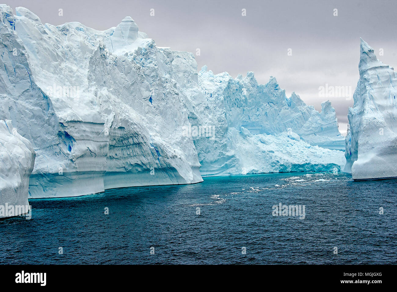Icebergs in Antarctica as seen from a zodiac boat. - Stock Image