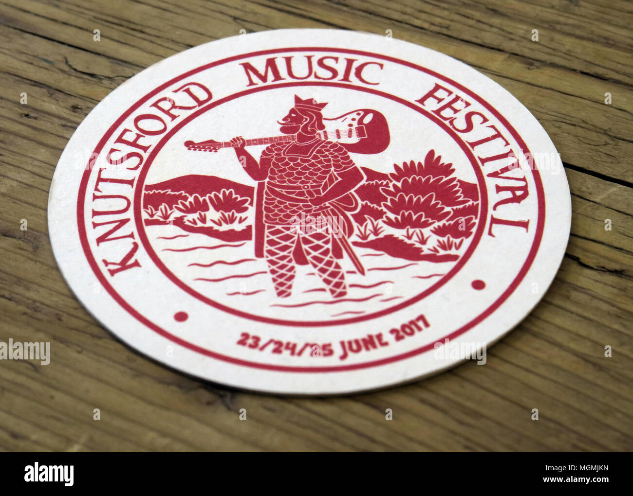 GoTonySmith,GB,Music,Festival,Beermat,Drip,Beer,Ale,CAMRA,mat,2017,22/23/24,22nd,23rd,24th,22nd June,annual,drinking,drinkers,history,historic,paper,white,red,man,holding,a,guitar,man holding guitar,on a table,mat on table,spill,alcohol,consumption,musical,heritage,play,playing,village,town