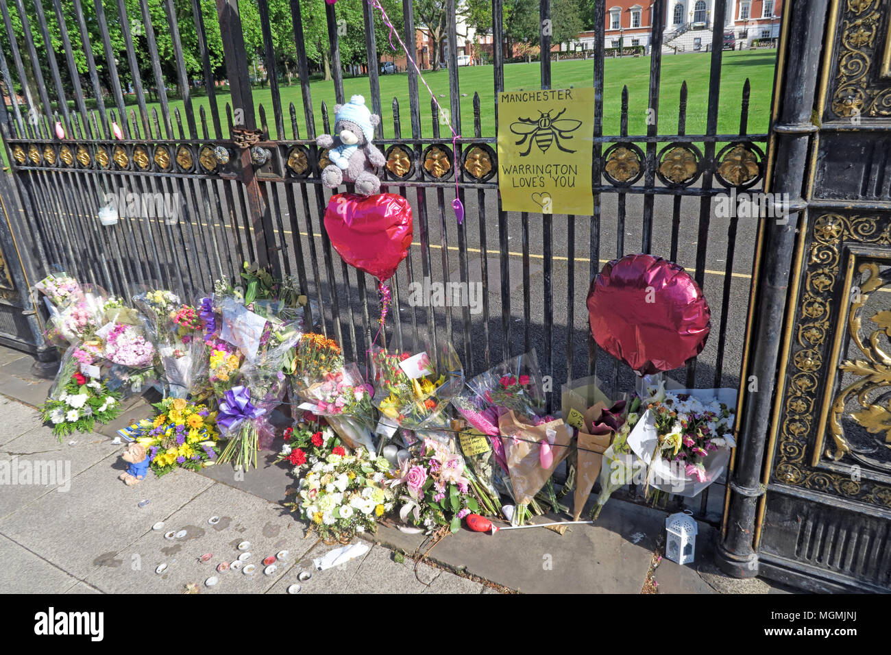 GoTonySmith,gate,after Manchester Bombing,aftermath,killed,maimed,2017,flowers,memorial,injured,Warrington Loves Manchester,Arena,Bomb,Bombing,Sankey St,balloons,balloon,sad,ceremony,prayers,people,united,uniting,coming together,community in shock,townhall,town hall,hall,WBC,gold,iron,work,iron work,bee,bee symbol,toys,left,bear,emotion