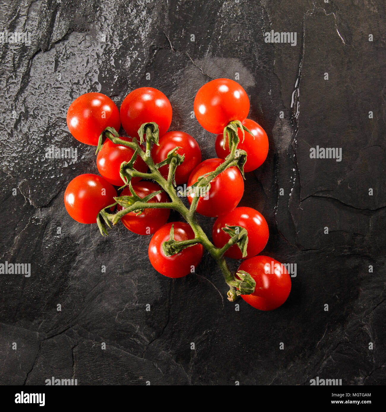 fresh-vine-tomatoes-on-slate-background-