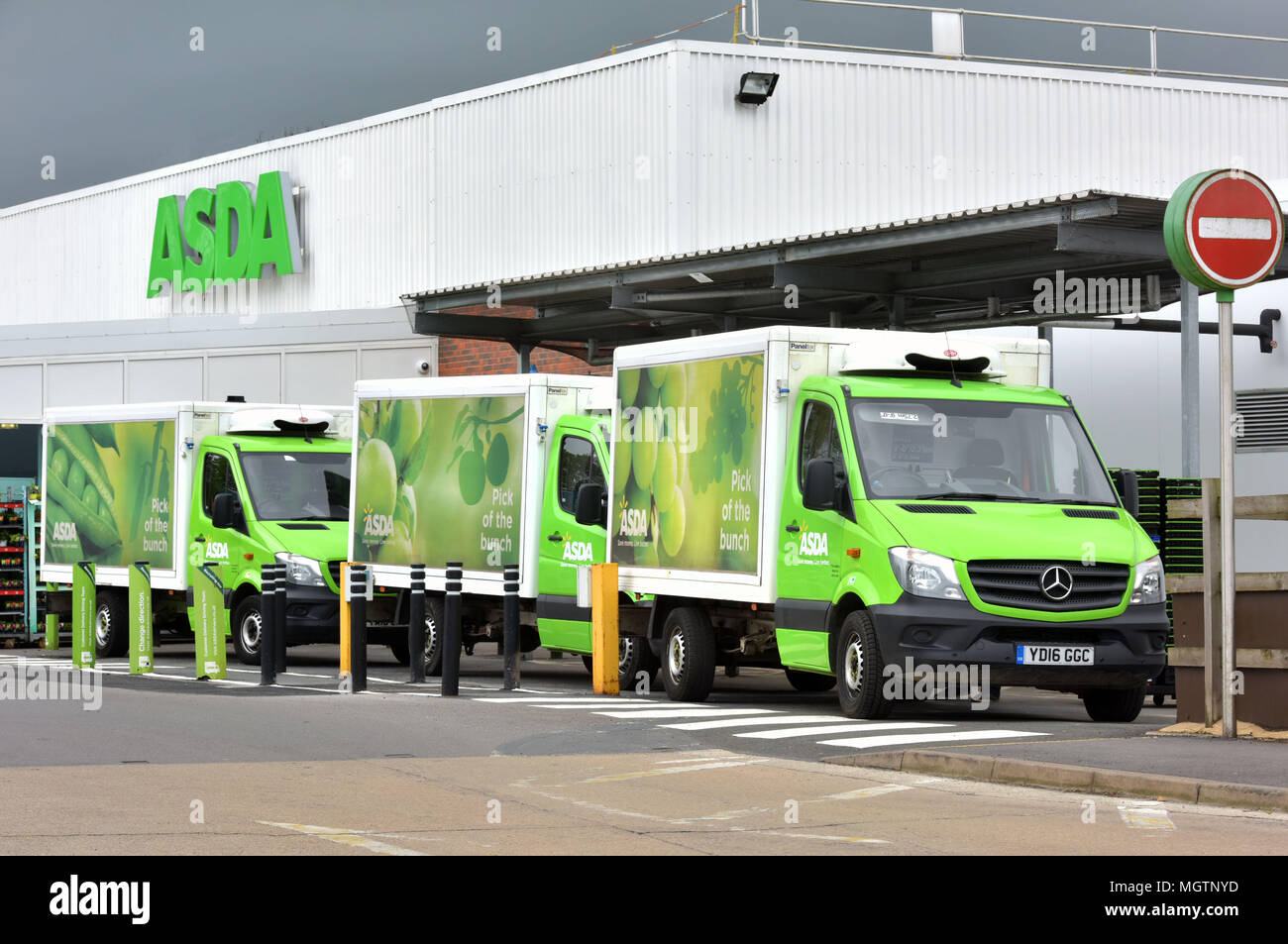 Online home delivery Asda trucks queue outside the Asda supermarket in Wheatley, Oxfordshire. Sainsburys and Asda are taking part in merger talks Stock Photo