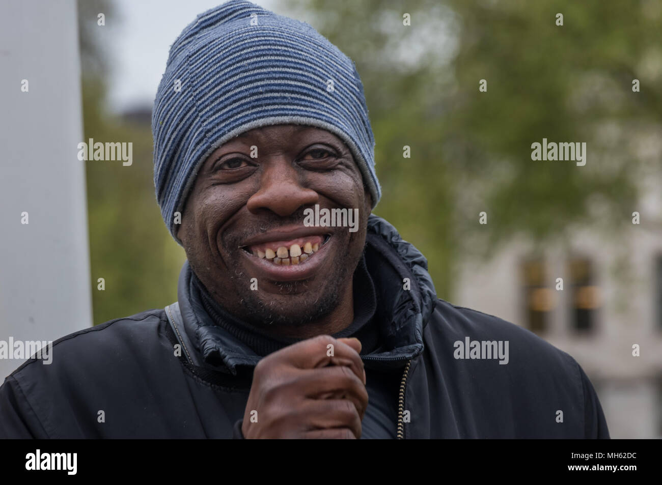 London, UK. 30th April 2018. Stand Up To Racism Co-Convenor Weyman Bennett speaks at the protest in support of the petition calling for an end to the deportations of migrants in the 'Windrush generation' who arrived in Britain between 1948 and 1971. It calls on the government to change the burden of proof which means they are now required to prove their right to remain, and to provide compensation for any loss and hurt. re for many years, paying taxes and raising fami Credit: Peter Marshall/Alamy Live News - Stock Image