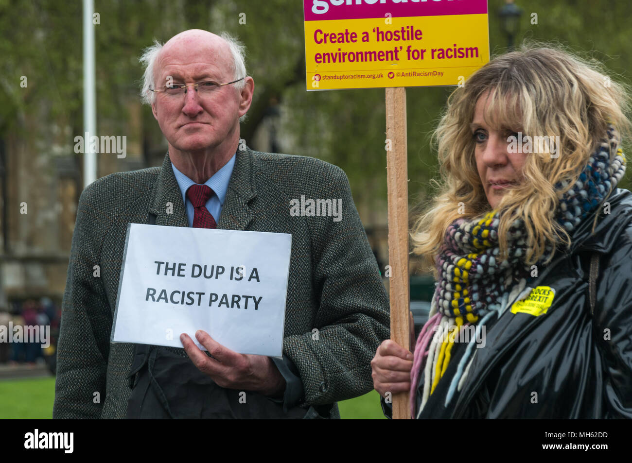 London, UK. 30th April 2018.  Irish activist Jim Curran holds a poster 'The DUP is a Racist Party' at the protest in support of the petition calling for an end to the deportations of migrants in the 'Windrush generation' who arrived in Britain between 1948 and 1971. It calls on the government to change the burden of proof which means they are now required to prove their right to remain, and to provide compensation for any loss and hurt.. re for many years, paying taxe Credit: Peter Marshall/Alamy Live News - Stock Image