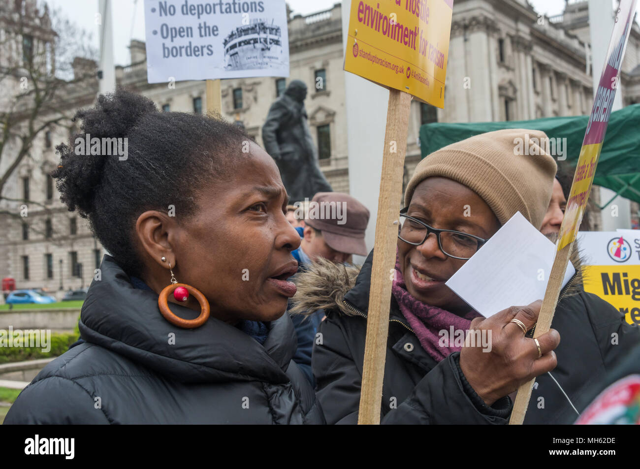 London, UK. 30th April 2018.  People talk in the crowd at the protest in support of the petition calling for an end to the deportations of migrants in the 'Windrush generation' who arrived in Britain between 1948 and 1971. It calls on the government to change the burden of proof which means they are now required to prove their right to remain, and to provide compensation for any loss and hurt.. re for many years, paying taxes and raising families here and have long re Credit: Peter Marshall/Alamy Live News - Stock Image