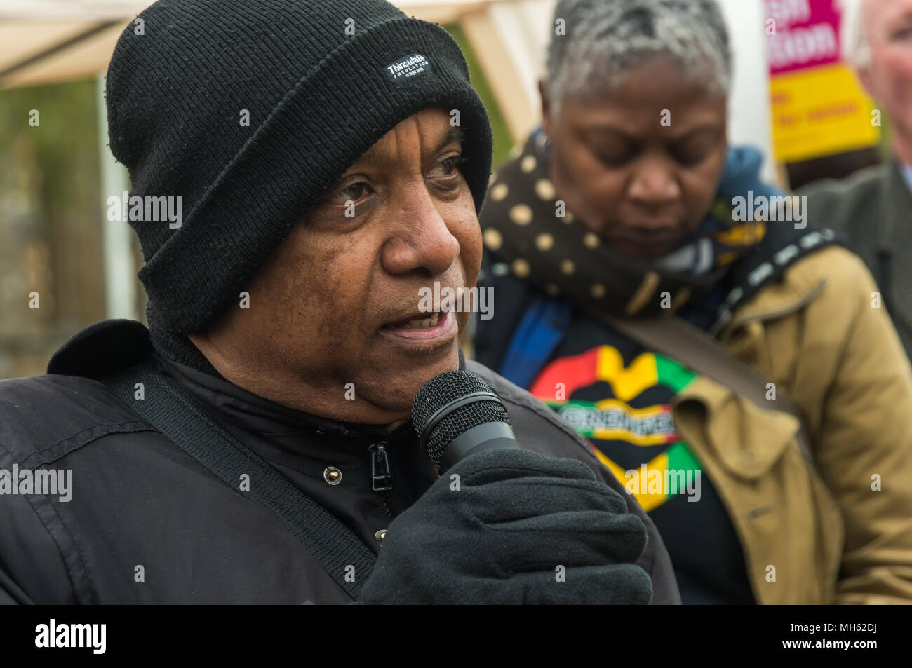 London, UK. 30th April 2018.  Smokey, one of the organisers of the Notting Hill Carnival who is fighting Kensington and Chelsea council to retain community control of the annual event speaks at the protest in support of the petition calling for an end to the deportations of migrants in the 'Windrush generation' who arrived in Britain between 1948 and 1971. It calls on the government to change the burden of proof which means they are now required to prove their right to remain, and to provide compensation for any loss and hurt.. Most of those who have been deported, threatened with deportation  - Stock Image