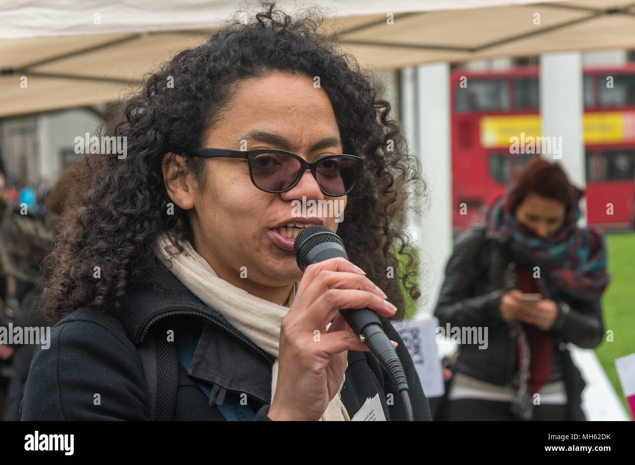 London, UK. 30th April 2018.  Antonia Bright of Movement for Justice speaks about their fight to stop deportations and to close Yarl's Wood and other immigration prisons at the protest in support of the petition calling for an end to the deportations of migrants in the 'Windrush generation' who arrived in Britain between 1948 and 1971. It calls on the government to change the burden of proof which means they are now required to prove their right to remain, and to provide compensation for any loss and hurt.. Most of those who have been deported, threatened with deportation or refused entry afte - Stock Image