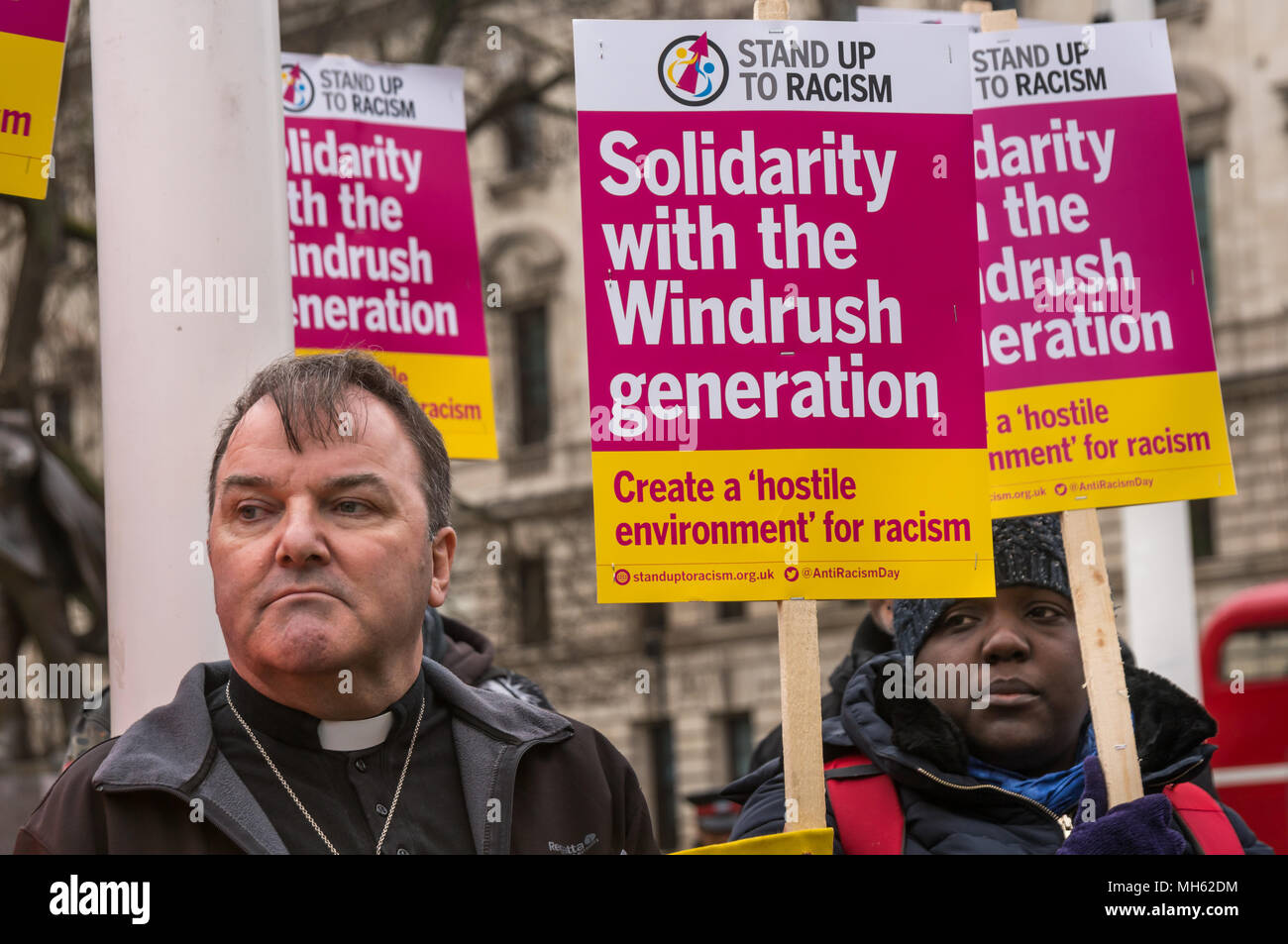 London, UK. 30th April 2018.  A man in a clerical collar at the protest in support of the petition calling for an end to the deportations of migrants in the 'Windrush generation' who arrived in Britain between 1948 and 1971. It calls on the government to change the burden of proof which means they are now required to prove their right to remain, and to provide compensation for any loss and hurt.. re for many years, paying taxes and raising families here and have long Credit: Peter Marshall/Alamy Live News - Stock Image