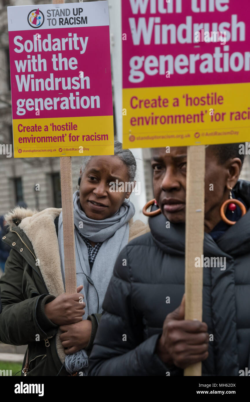 London, UK. 30th April 2018.  Women with placards at the protest in support of the petition calling for an end to the deportations of migrants in the 'Windrush generation' who arrived in Britain between 1948 and 1971. It calls on the government to change the burden of proof which means they are now required to prove their right to remain, and to provide compensation for any loss and hurt.. re for many years, paying taxes and raising families here and have long regarde Credit: Peter Marshall/Alamy Live News - Stock Image