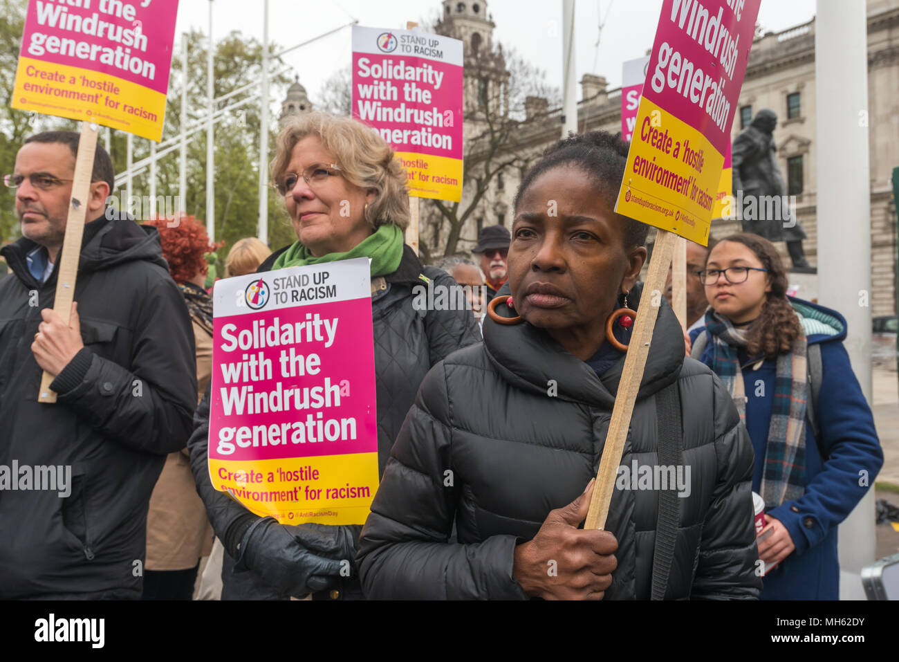 London, UK. 30th April 2018.  People with placards at the protest in support of the petition calling for an end to the deportations of migrants in the 'Windrush generation' who arrived in Britain between 1948 and 1971. It calls on the government to change the burden of proof which means they are now required to prove their right to remain, and to provide compensation for any loss and hurt.. re for many years, paying taxes and raising families here and have long regard Credit: Peter Marshall/Alamy Live News - Stock Image