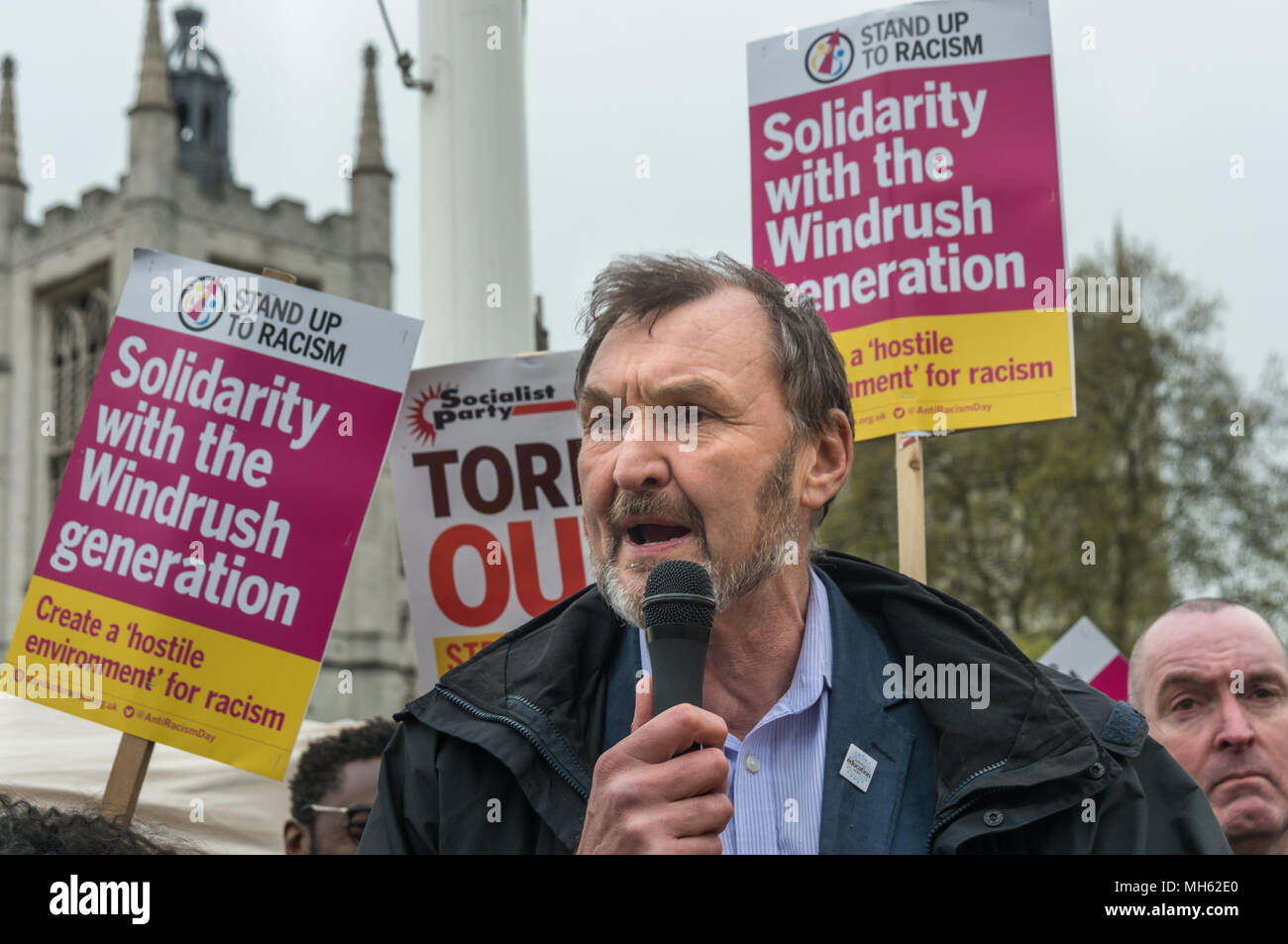 London, UK. 30th April 2018.  NEU General Secretary Kevin Courtney speaks at the protest in support of the petition calling for an end to the deportations of migrants in the 'Windrush generation' who arrived in Britain between 1948 and 1971. It calls on the government to change the burden of proof which means they are now required to prove their right to remain, and to provide compensation for any loss and hurt.. re for many years, paying taxes and raising families he Credit: Peter Marshall/Alamy Live News - Stock Image