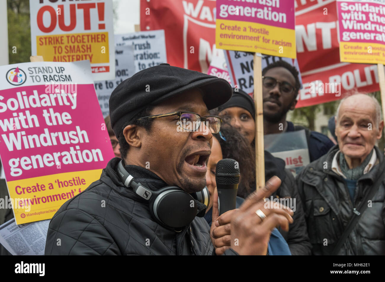 London, UK. 30th April 2018. Brian Richardson of Stand Up To Racism speaks at the protest in support of the petition calling for an end to the deportations of migrants in the 'Windrush generation' who arrived in Britain between 1948 and 1971. It calls on the government to change the burden of proof which means they are now required to prove their right to remain, and to provide compensation for any loss and hurt.. re for many years, paying taxes and raising families h Credit: Peter Marshall/Alamy Live News - Stock Image