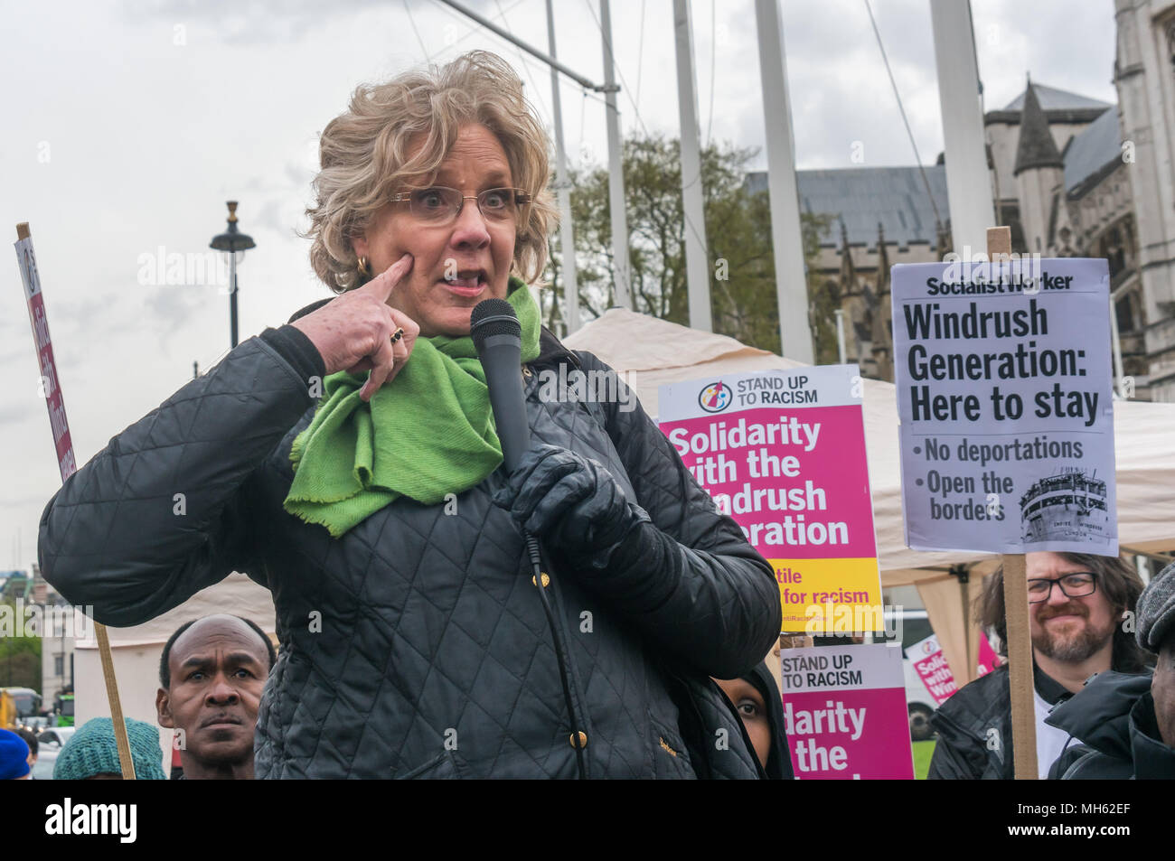 London, UK. 30th April 2018.  A woman who was born in Jamaica tells us she has never, ever, had her immigration status questioned and points a finger into the skin of her cheek to show us why - she is white and immigration controls are racist. The protest was in support of the petition calling for an end to the deportations of migrants in the 'Windrush generation' who arrived in Britain between 1948 and 1971. It calls on the government to change the burden of proof which means they are now required to prove their right to remain, and to provide compensation for any loss and hurt.. Most of thos - Stock Image