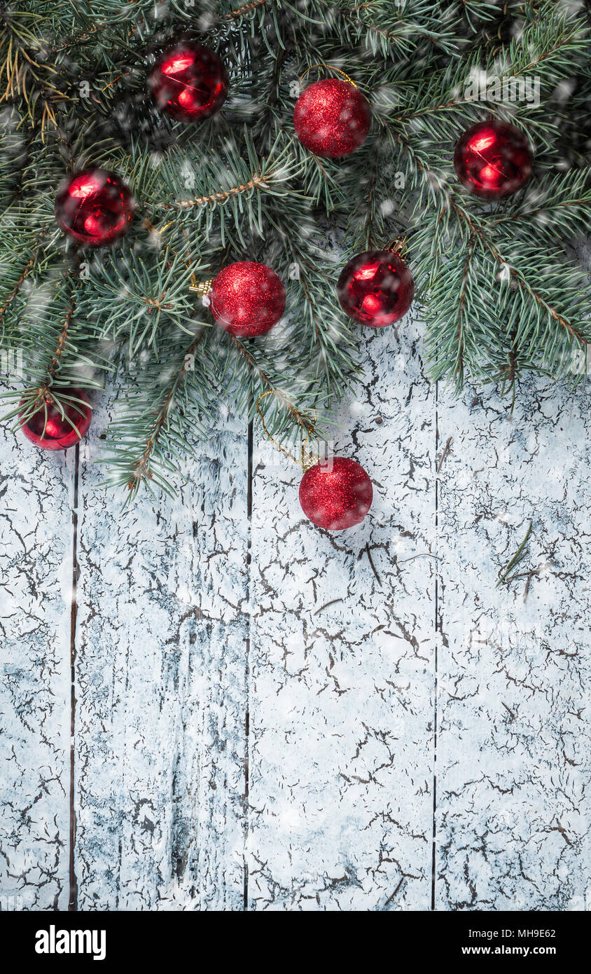 branches of a christmas tree on old boards christmas background christmas decorations new year background xmax background toned image falling sn