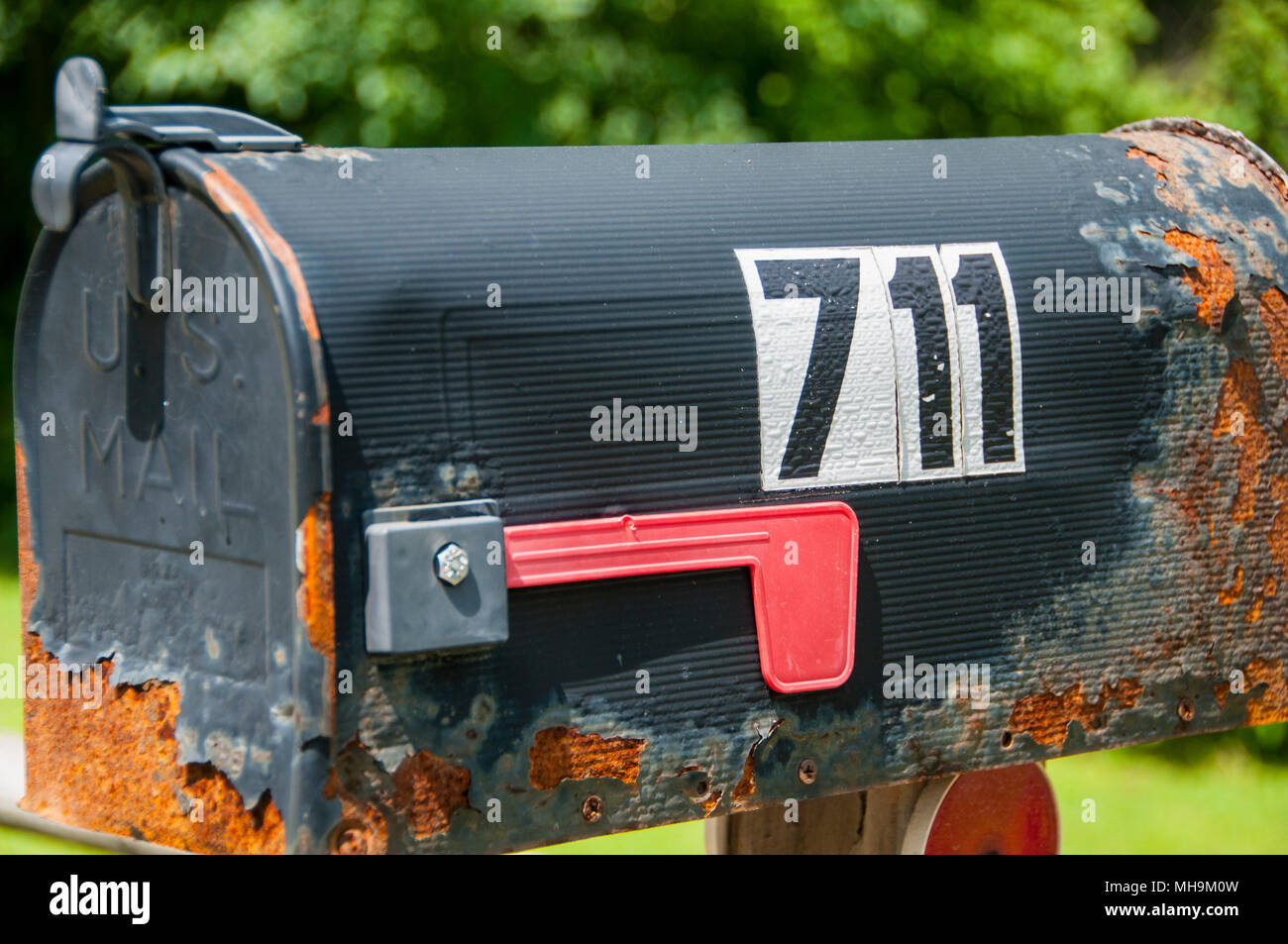 Rusty old mailbox in New Hampshire, USA - Stock Image