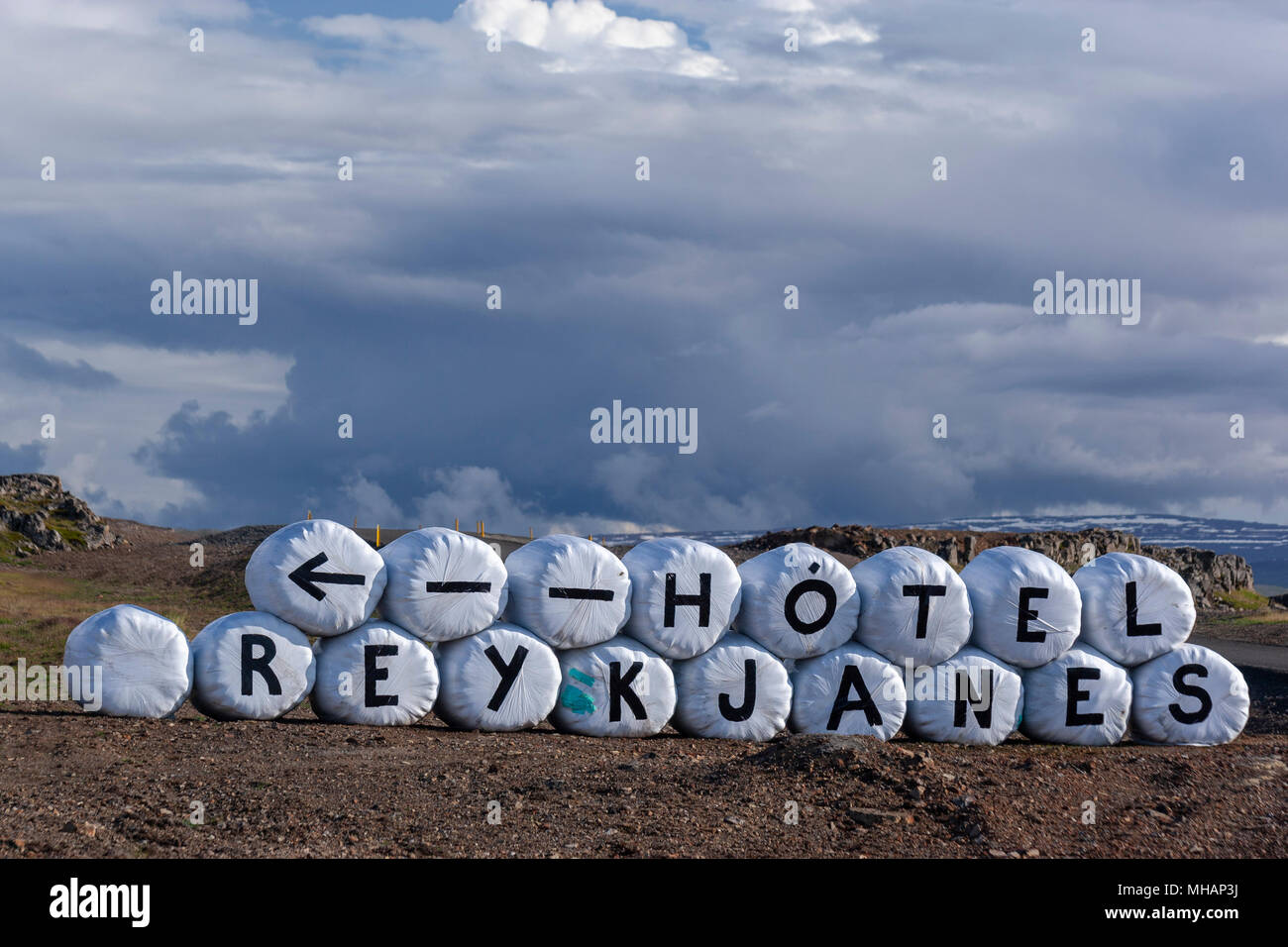To Hotel Reykjanes sign in bwhite bales, with Hot Springs,  located on the Reykjanes peninsula in Isafjardardjup by the main road, Iceland Stock Photo