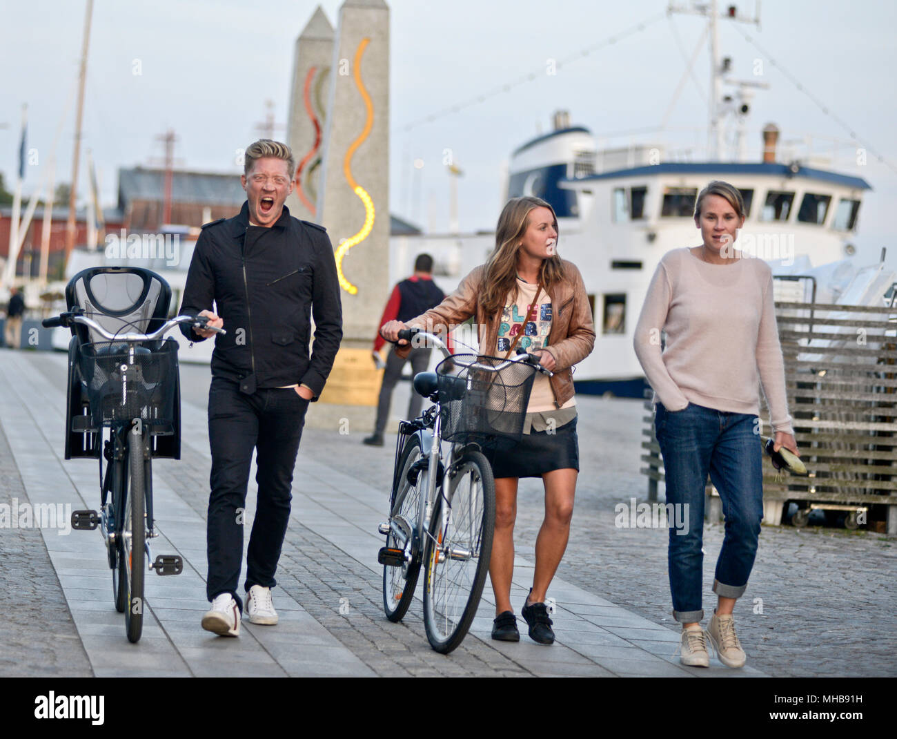 Swedish family walking by the streets with their bikes, Stockholm ...