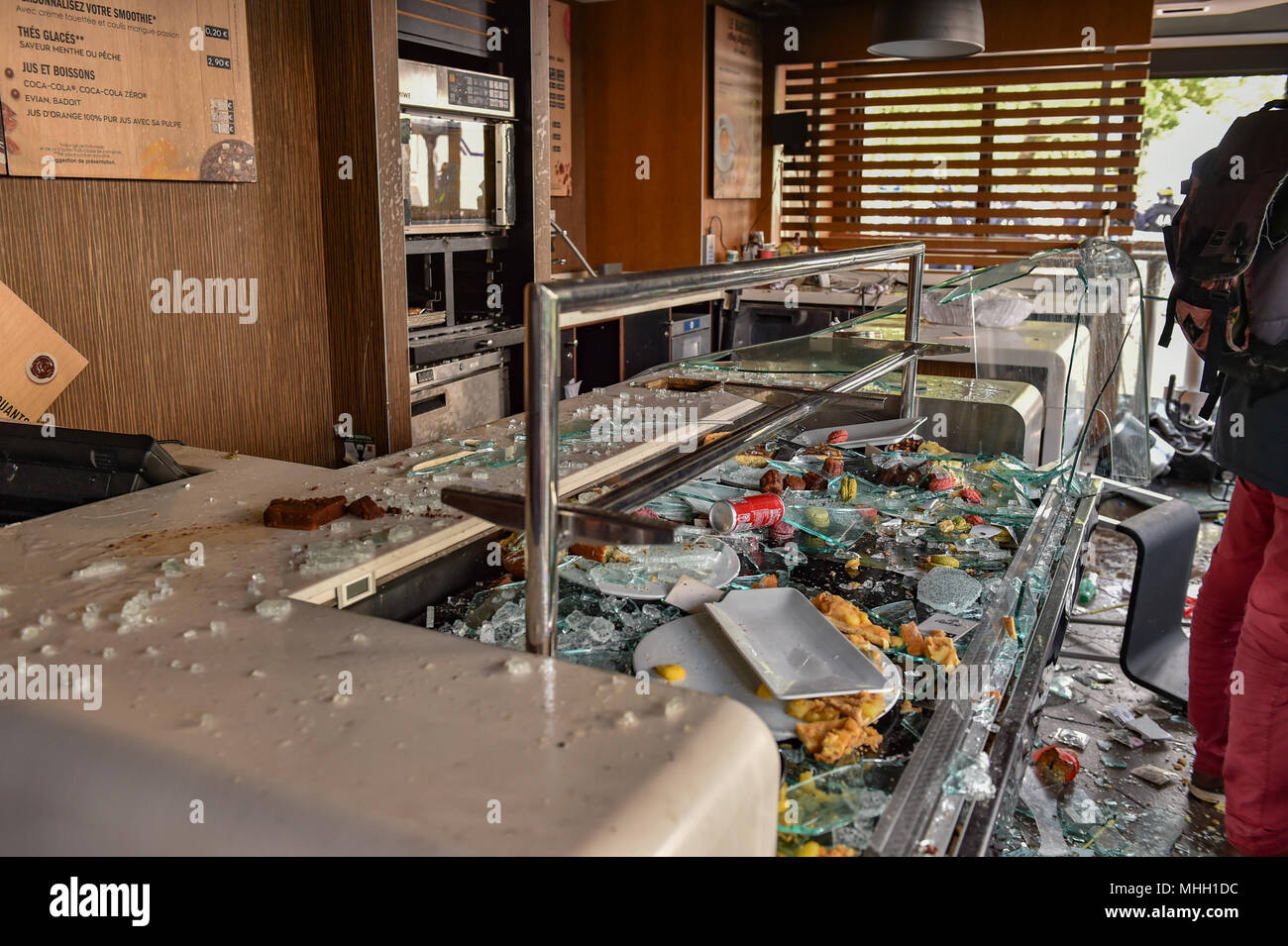 Paris, France. 1st May 2018. Paris police clash with protesters as demonstrations turn violent. PICTURED: 'Black Bloc' protesters smashed their way into a McDonald's restaurant and caused significant damage. Credit: Peter Manning/Alamy Live News - Stock Image