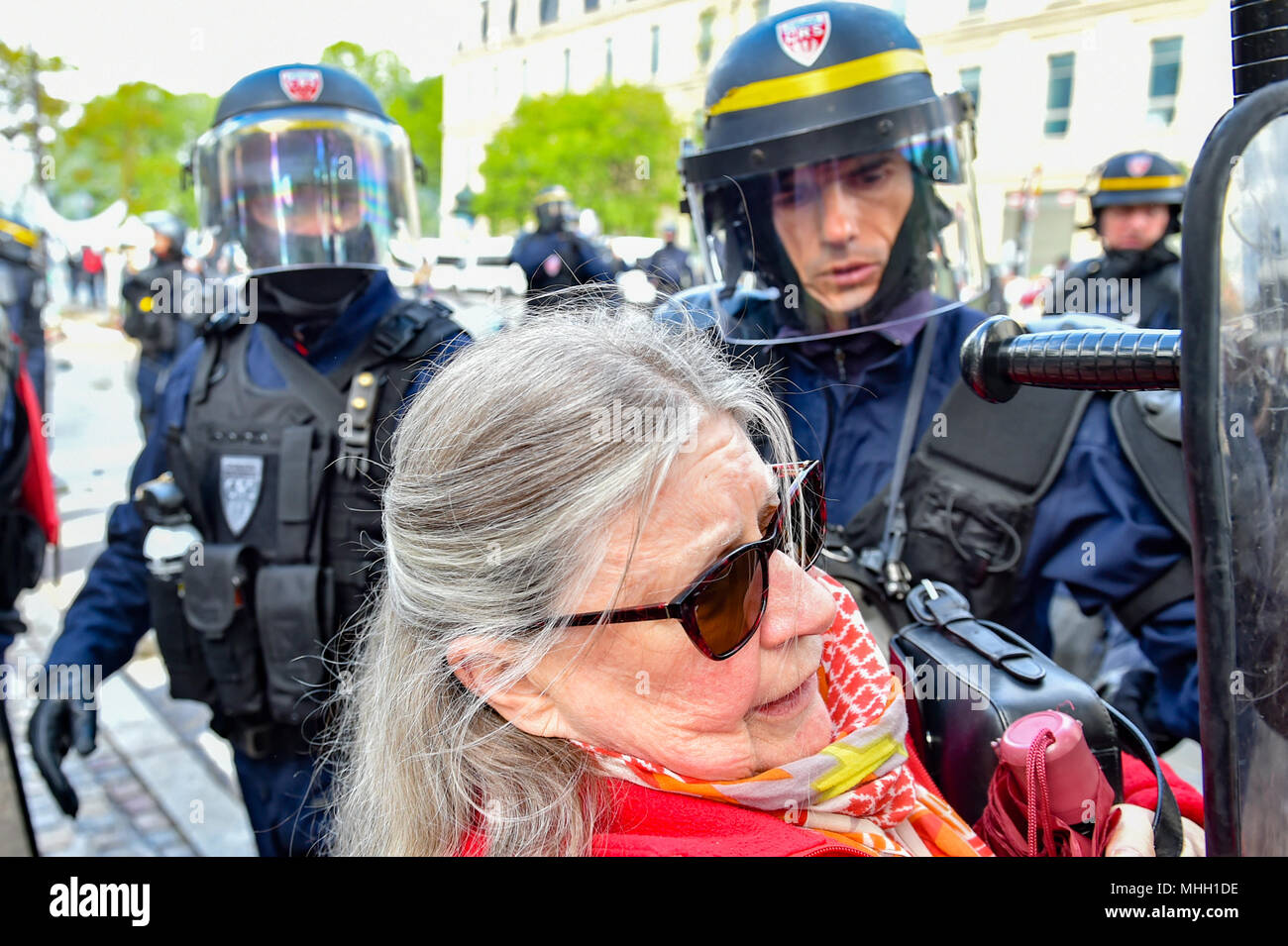 Paris, France. 1st May 2018. Paris police clash with protesters as demonstrations turn violent. PICTURED: A elderly woman is pushed by police. Credit: Peter Manning/Alamy Live News - Stock Image