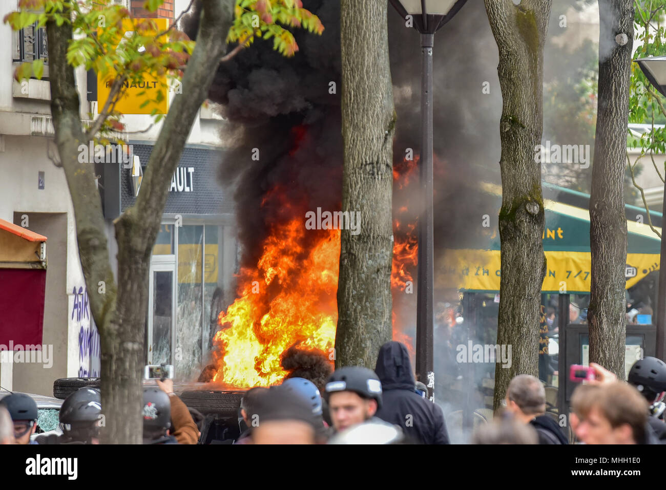 Paris, France. 1st May 2018. Paris police clash with protesters as demonstrations turn violent. PICTURED: 'Black Bloc' protesters smashed their way into a Renault car showroom and set a motorbike on fire. Credit: Peter Manning/Alamy Live News - Stock Image