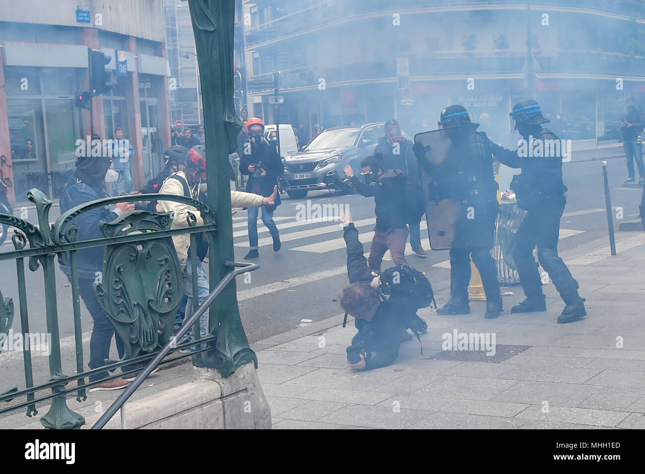 Paris, France. 1st May 2018. Paris police clash with protesters as demonstrations turn violent. PICTURED: A press photographer is pushed to the ground by police. Credit: Peter Manning/Alamy Live News - Stock Image