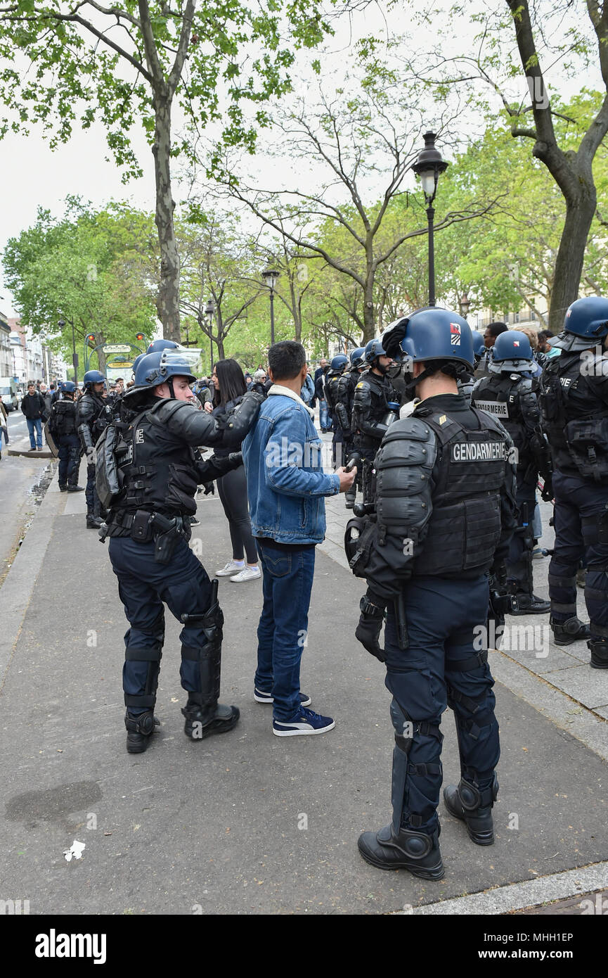 Paris, France. 1st May 2018. Paris police clash with protesters as demonstrations turn violent. PICTURED: suspected 'Black Bloc' protesters are detained and searched by police. Credit: Peter Manning/Alamy Live News Stock Photo