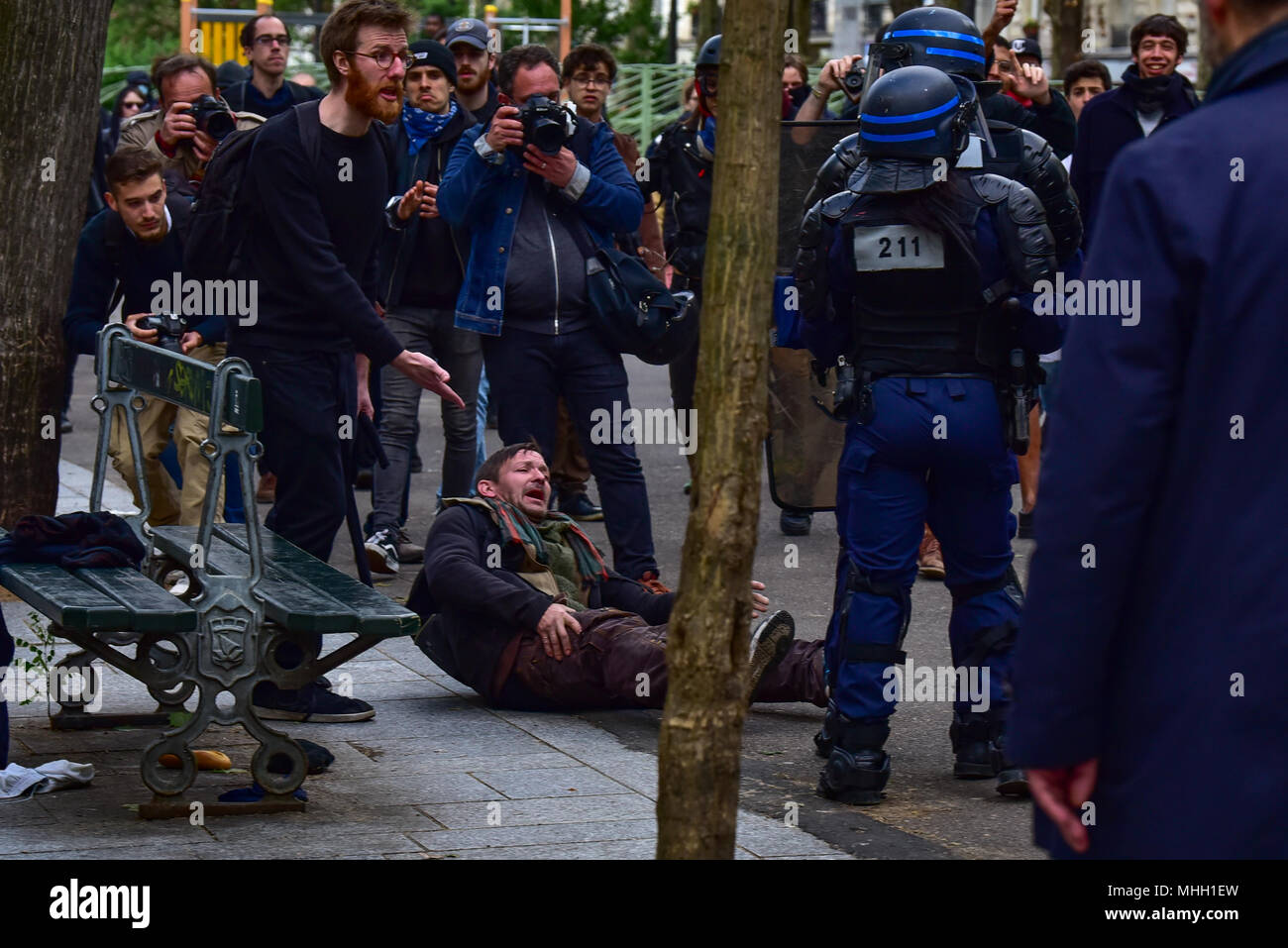 Paris, France. 1st May 2018. Paris police clash with protesters as demonstrations turn violent. PICTURED: A man is pushed to the ground by police. Credit: Peter Manning/Alamy Live News - Stock Image
