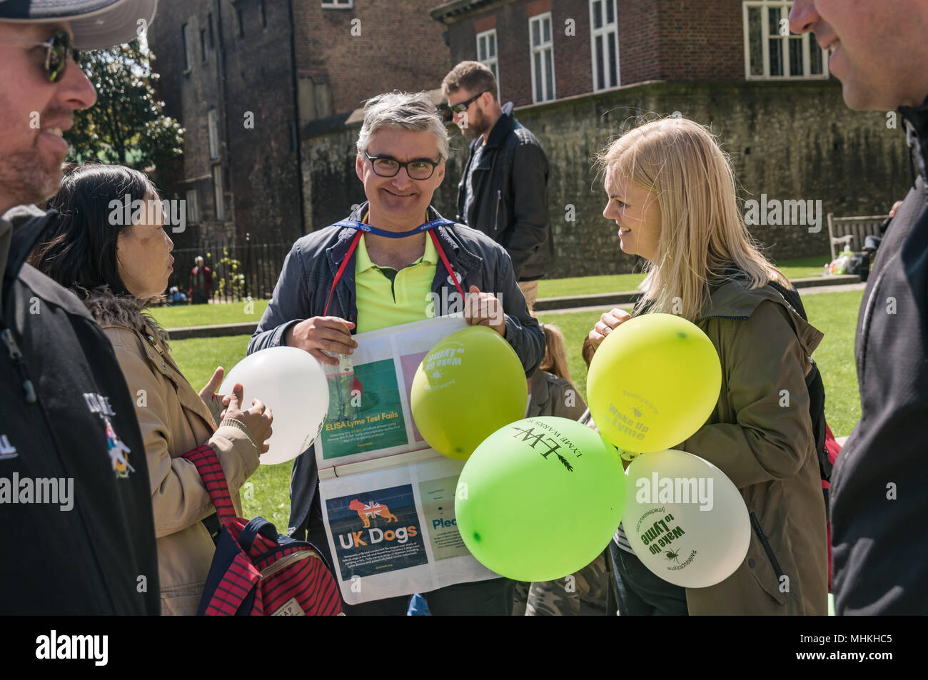 London, UK. 1st May 2018. Campaigners at Parliament highlighted the serious dangers of Lyme Disease from tick bites, calling for public education and for the NHS to abandon useless tests and tackle this killing disease seriously with effective tests and treatments. The danger can be lessened by appropriate clothing on walks through long grass or woods and by prompt and correct removal of ticks attached to skin using a simple device. Credit: Peter Marshall/Alamy Live News - Stock Image