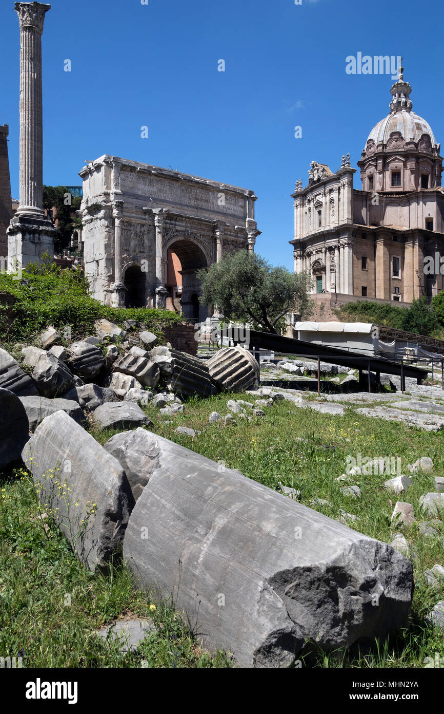 The Roman Forum - Rome - Italy. The Arch of Septimius Severus, the church of Santi Luca-e-Martina and the Column of Phocas. - Stock Image
