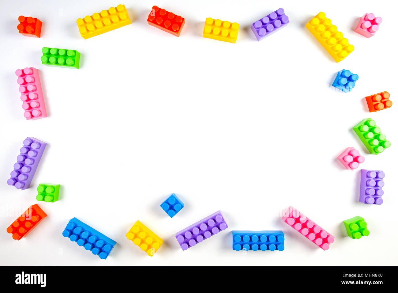 Colorful plastic construction blocks on white background as kids ...
