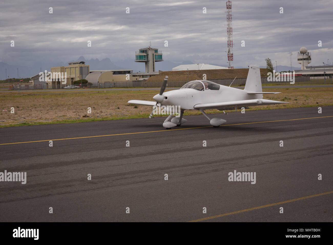 Aircraft taxiing on runway - Stock Image