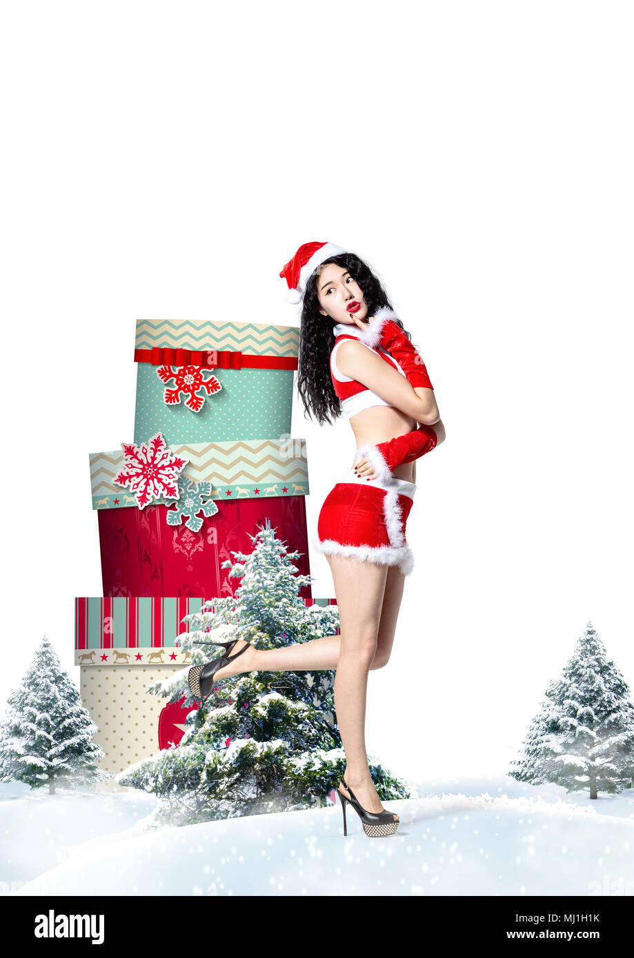 Young women and Christmas gifts Stock Photo: 183202815 - Alamy