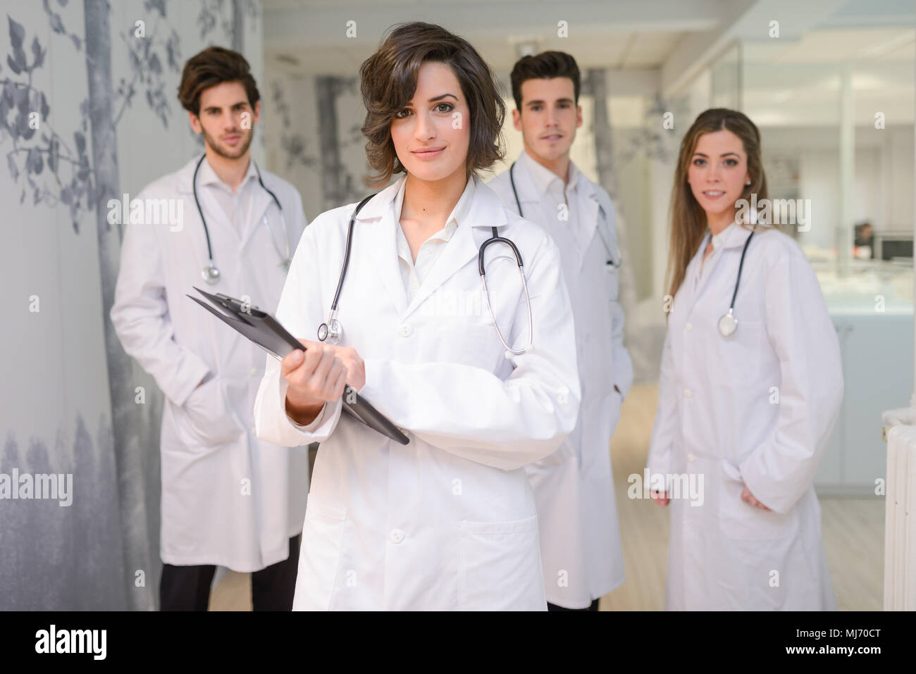 Portrait of group of medical workers portrait in hospital - Stock Image