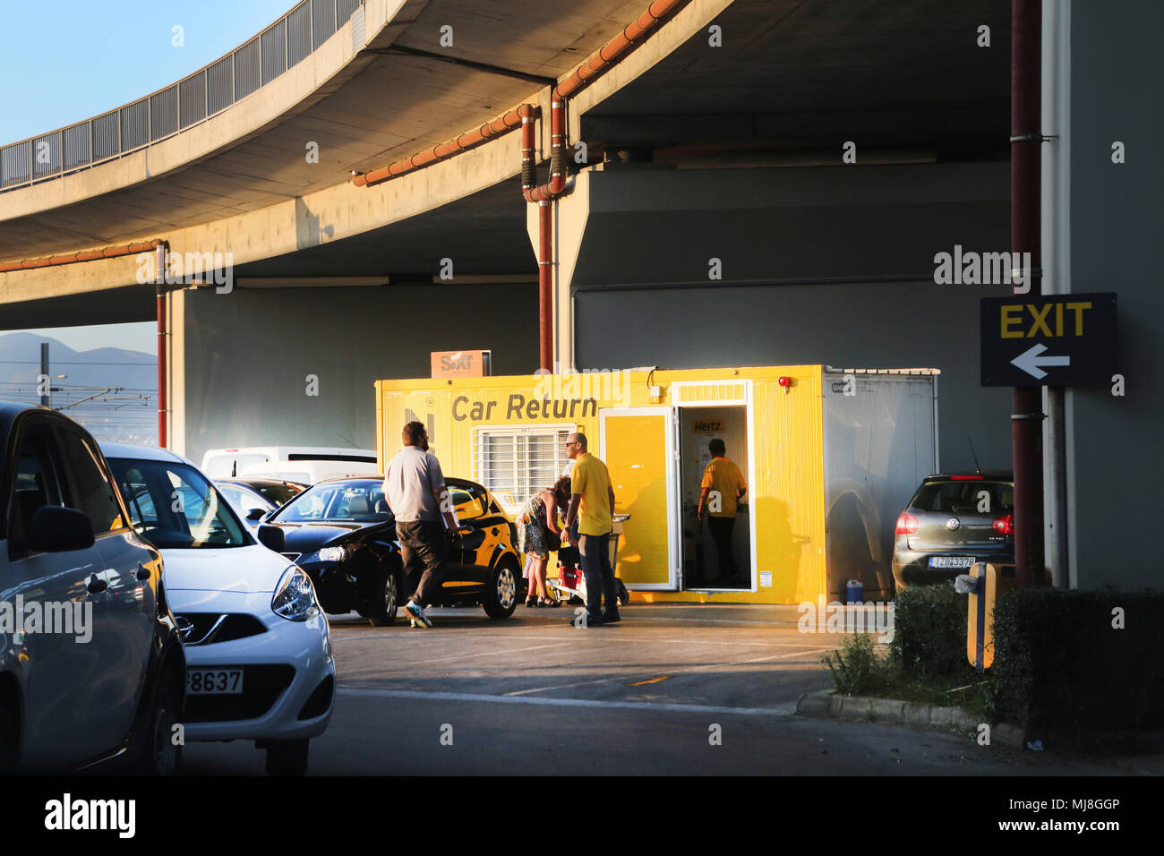 Car Rental under Flyover at Athens Airport Greece - Stock Image