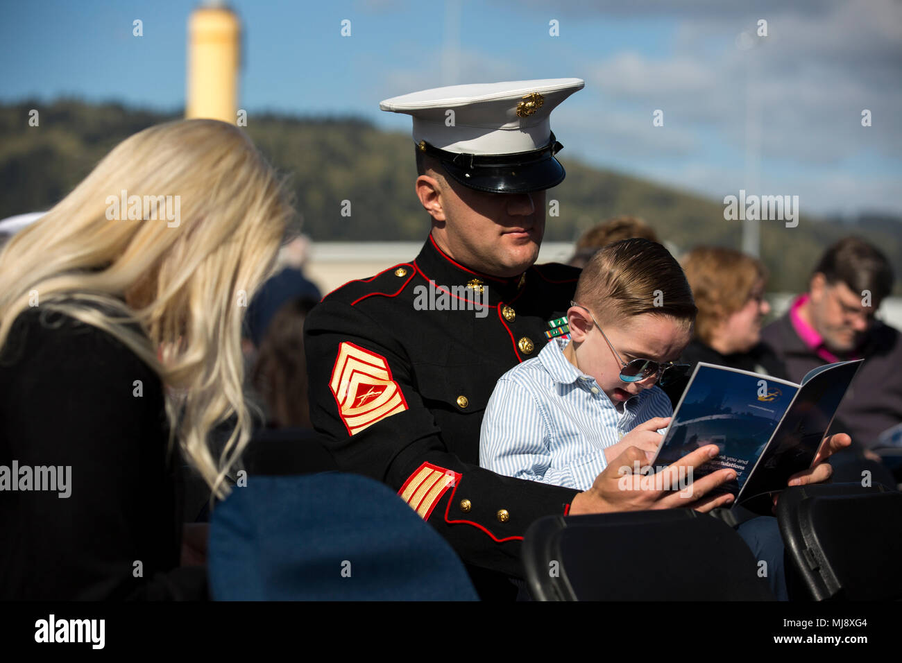 master sgt paul d tritch and his son read a program guide before rh alamy com navy instruction guide watch standing navy instruction guide watch standing